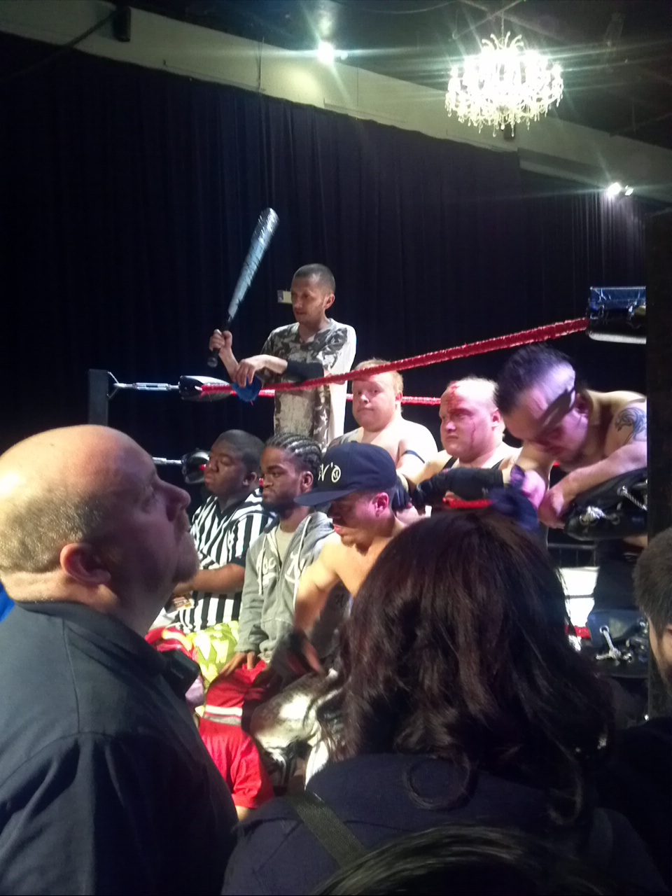 Clockwise from top: Skinny Timmy, Baby Jesus, Lil Show, Canadian, Steve-O, King Midget, and the ref